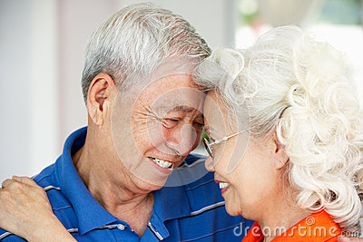 Loving Senior Chinese Couple Together At Home