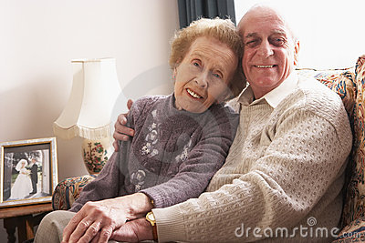 Loving Senior Couple Relaxing At Home