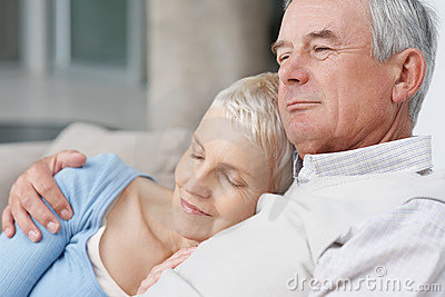 Loving senior man with wife resting on his chest