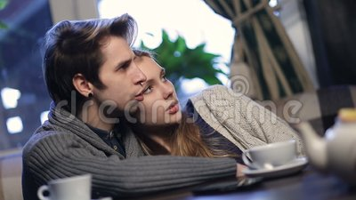 Loving young couple hugging while resting in cafe stock video footage