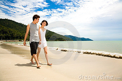 Loving young couple walking along the beach