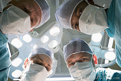 Low Angle View Of Four Surgeons