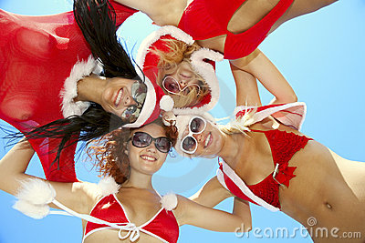 Low angle view of happy girls in christmas suit