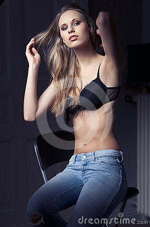 Low key fashion shot of sexy girl with bra