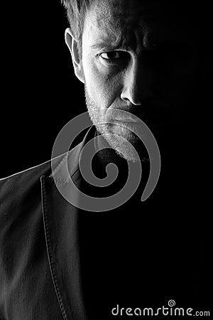 Low key portrait of mid age man