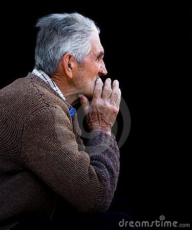 Low key portrait of an old man