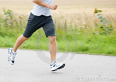 Low section image of a athlete jogging