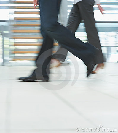 Low section motion of business people walking