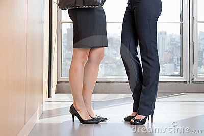 Low Section Of Two Female Executives In High Heels