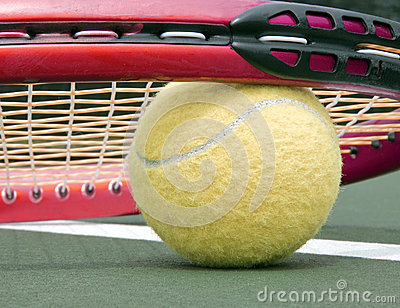 Low tennis ball and racket close up