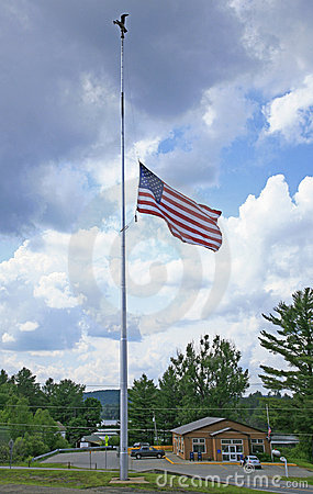 Lowered, half-mast American flag on flagpole