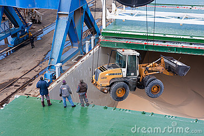 Lowering loader into the hold Editorial Photo