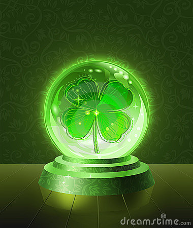 Lucky four-leaf clover inside the crystal ball
