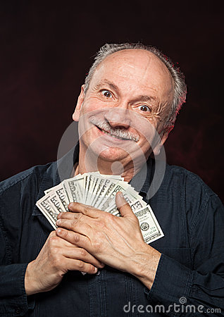 Lucky old man with dollar bills