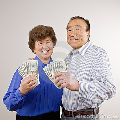 Lucky, wealthy couple holding group of twenties