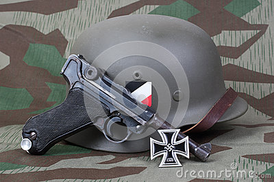 Luger P08 Parabellum handgun, helm and medal Iron Cross