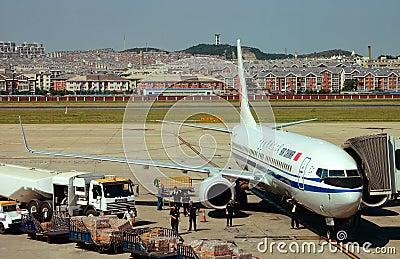 Luggage transport plane Editorial Image