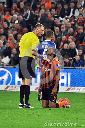 Luiz Adriano and referee Editorial Photo