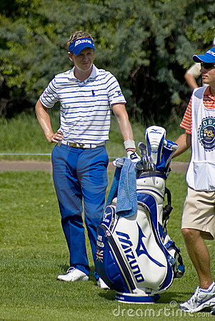 Luke Donald and Caddy Editorial Photo