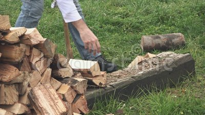 lumberjack chopping firewood with axe stock footage video 64739144