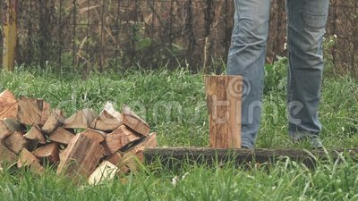 lumberjack chopping firewood with axe stock video video 64794161