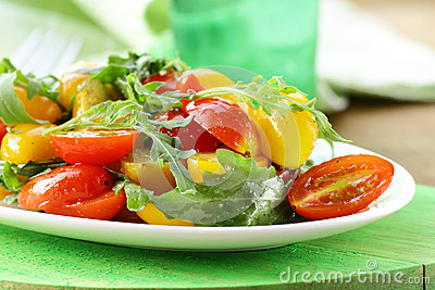 Lunch fresh salad with arugula and  tomatoes