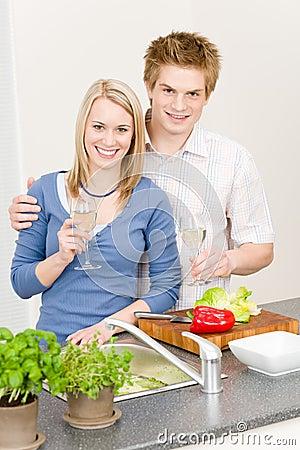 Lunch happy couple cook salad enjoy wine