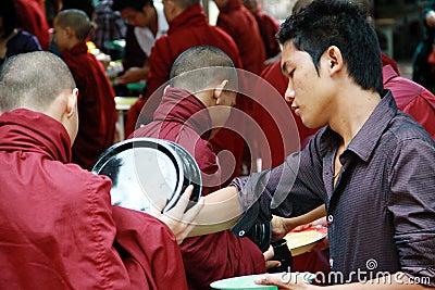 Daily lunch ritual in Amarapura Monastry, Myanmar Editorial Stock Photo