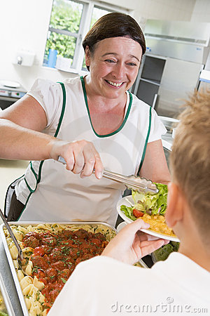 Free Lunchlady Serving Plate Of Lunch In A School Royalty Free Stock Images - 6080889