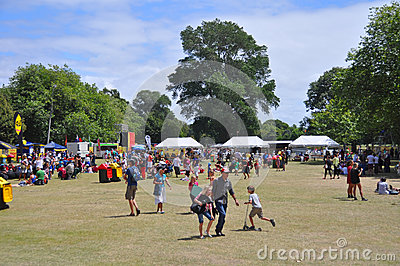 Lunchtime Crowd in Hagley Park at The World Buskers Festival, Ne Editorial Stock Image