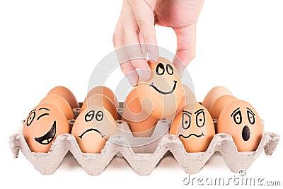 lustige gesichter gemalt auf braunen eiern in einem beh lter lizenzfreie stockfotos bild 37054558. Black Bedroom Furniture Sets. Home Design Ideas