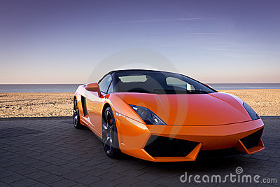 Luxurious sexy orange sports car near beach