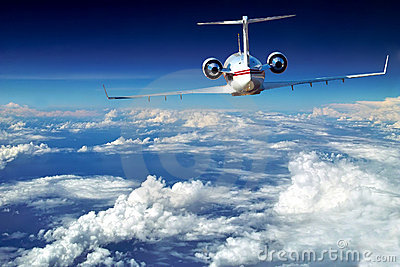 Luxury airplane. Above beautiful clouds.