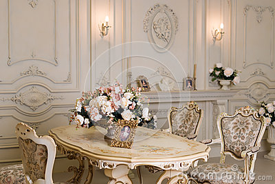 Luxury apartment, comfortable classic living room. Luxurious vintage interior with fireplace in the aristocratic style. Stock Photo