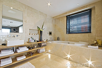 Luxury bathroom with light brown marble