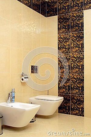 Luxury bathroom with toilet sink and bidet