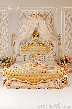 Free Luxury Bedroom In Light Colors With Golden Furniture Details. Big Comfortable Double Royal Bed In Elegant Classic Stock Image - 91335891