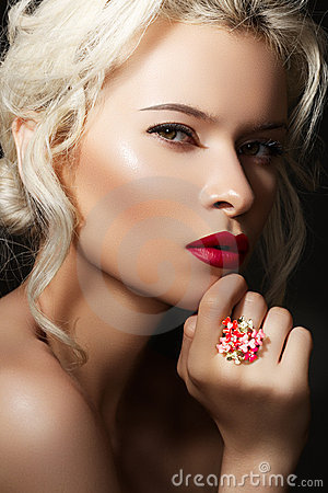 Luxury blond model with red lips & bright jewelry