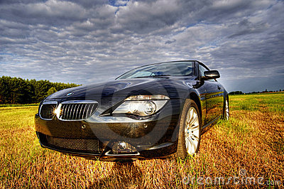 Luxury bmw cabriolet in rural scene, hdr