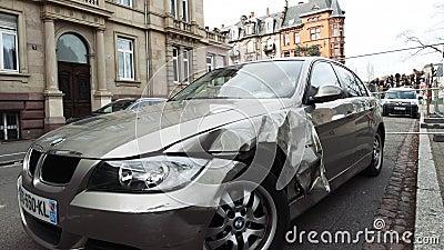 Luxury BMW German car parked city street damaged car accident insurance