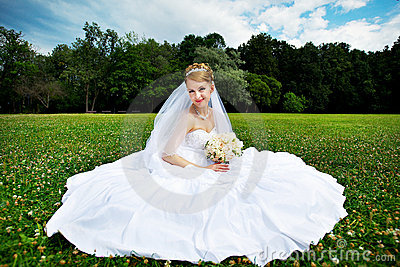 Luxury bride on the grass