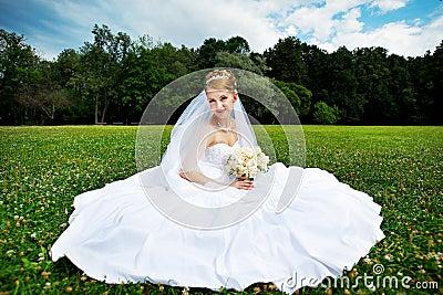 Luxury bride on the grass