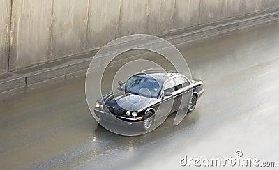 Luxury british car jaguar in high speed motion