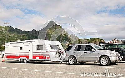 Luxury car caring caravan with bikes on