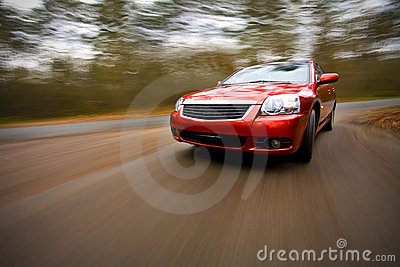 Luxury car driving fast