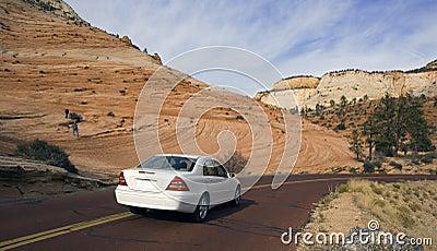 Luxury car driving in Utah.