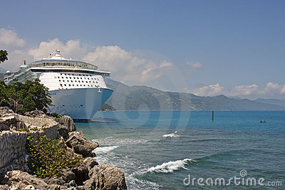 Luxury Cruise Ship Anchored Along Rocky Coast