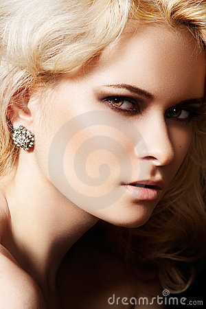 Luxury and fashion style. Female face with make-up