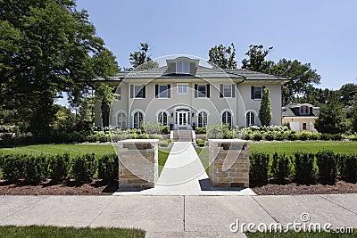 Luxury home with stone pillars
