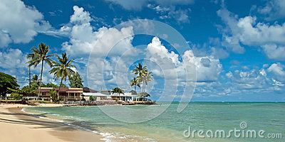 Luxury house on untouched sandy beach with palms trees and azure
